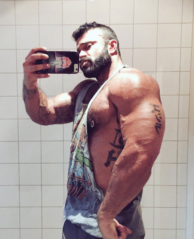 Insanely muscular Rogan Richards pumps iron at gym