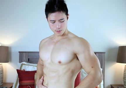 Muscular & hung Asian hunk jerks off