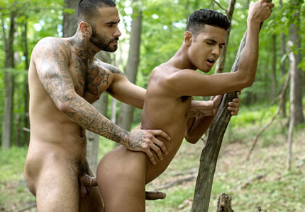 tattooed-rikk-york-fucks-smaller-kris-karr-in-the-woods